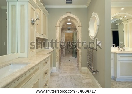 Master bath with arched shower entry - stock photo