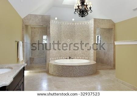 Master bath with circular tub - stock photo