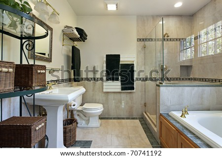 Master bath with glass shower tub with oak wood cabinetry - stock photo