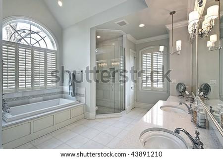 Master bath with oval window - stock photo