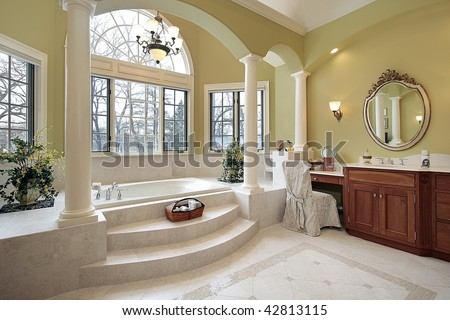 Master bath with wall of windows - stock photo
