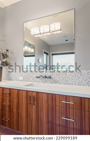 Master Bathroom Vanity with Sink, Cabinets, and Mirrors - stock photo