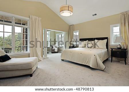 Master bedroom in luxury condominium with sitting room - stock photo