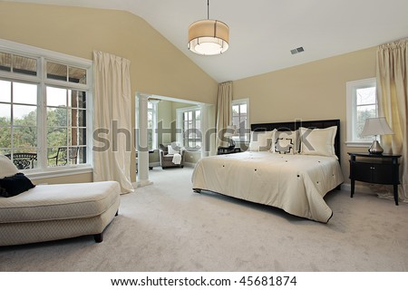 Master bedroom in luxury condominium with sitting room [best for web use] - stock photo
