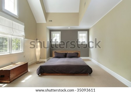 Master bedroom in luxury home - stock photo
