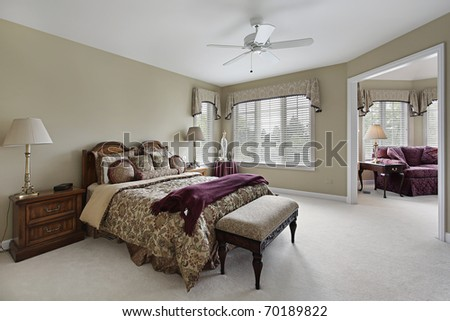 Master bedroom in luxury home with adjacent sitting room - stock photo