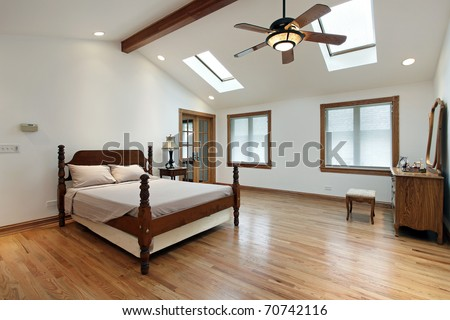 Master bedroom in luxury home with two skylights - stock photo