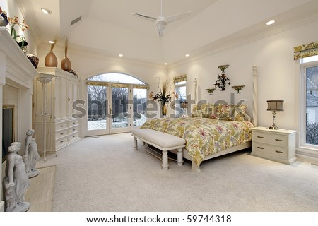 master bedroom in luxury home with white fireplace - Luxury Homes Master Bedroom