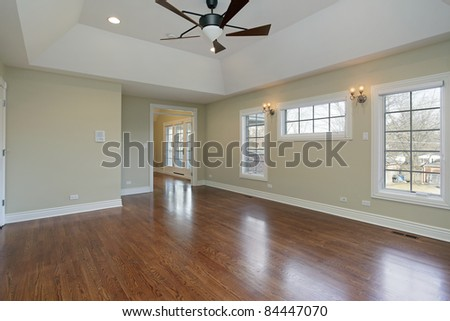 Master bedroom in remodeled home with vaulted ceiling - stock photo