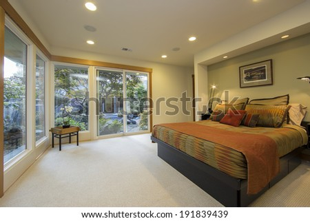 Master bedroom suite open to the atrium / zen garden - stock photo