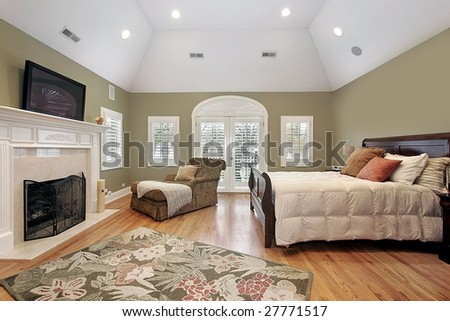 Master bedroom with fireplace - stock photo
