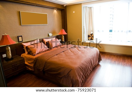 Master bedroom with king size bed. - stock photo