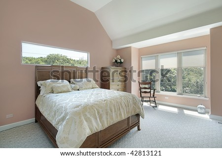 Master bedroom with salmon colored walls - stock photo