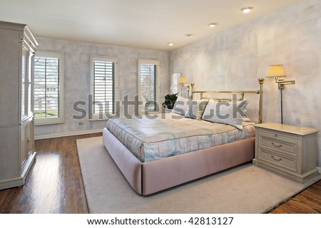 Master bedroom with wall paper design - stock photo