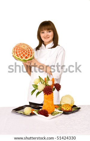 Master carving food with a composition - stock photo