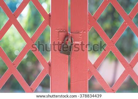 master key on  iron gate background. - stock photo