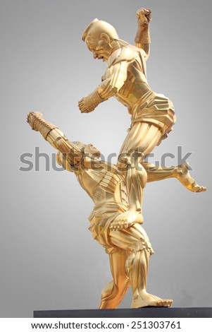 Master of Arts Muay Thai floating gilded bronze isolated on gray background. Grunge Thai boxing. This has clipping path. - stock photo