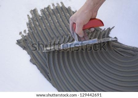 Master puts adhesive - stock photo