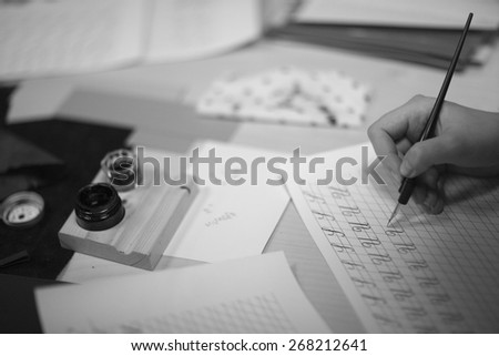 Mastering the art of calligraphy - stock photo