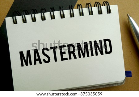 Mastermind memo written on a notebook with pen - stock photo