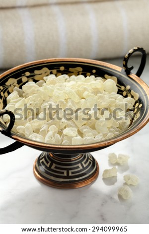 Mastic tears of Chios in a Greek bowl for cosmetic use - stock photo