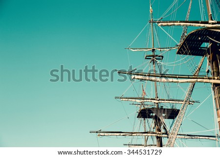Masting of the big wooden sailing ship. Background - stock photo