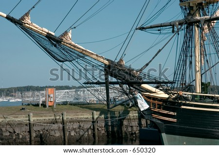 "Masts and prow  of the  historic ship named ""Three masted Friendship"" anchored  in Salem harbor, Massachusetts"