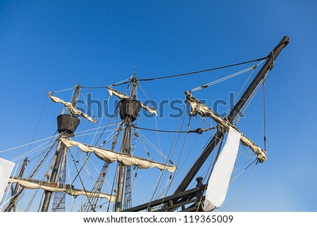 Masts and rigging of a pirate ship - stock photo
