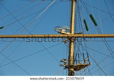 Masts and rigging of a sailing ship - stock photo