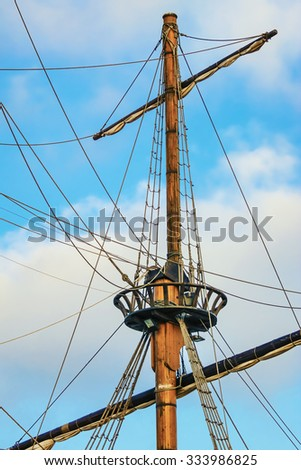 Masts Of Sailboats against the Cloudy Sky - stock photo