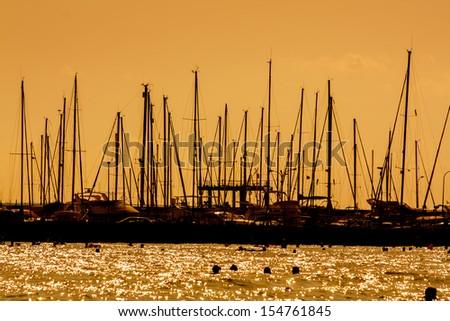 Masts of yacht in marine - stock photo