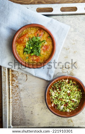 Masur dal indian soup  with tomato, red lentil and onion in bowl on the tray rustic style - stock photo