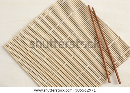 mat for sushi and chopsticks sushi place for inscription - stock photo