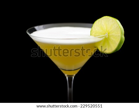 Matador cocktail, consisting of tequila, freshly squeezed lime juice, pineapple juice and garnished with a lime slice - stock photo