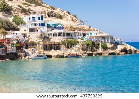 MATALA, CRETE, GREECE - APRIL 18. Restaurants, pubs and dwellings in the bay of Matala in south Crete on April 18, 2016. Famous by the caves, Matala also known as a hippie destination from the 70s - stock photo