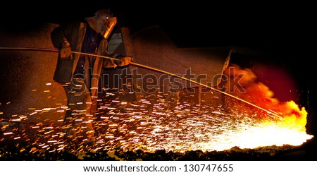 matallurgic production, production of cast iron, metal melting - stock photo