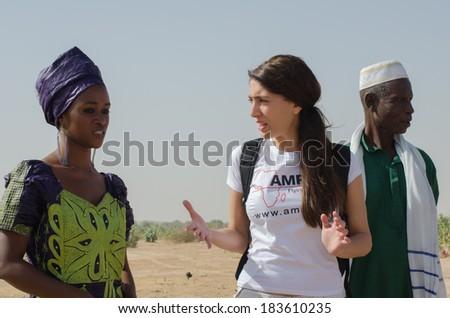 MATAM,SENEGAL-CIRCA NOVEMBER 2013:Actress Caterina Murino speaks with an elementary school teacher in the region of Matam,Senegal, Caterina Murino is the testimonial of the NGO AMREF,circa Nov. 2013.  - stock photo
