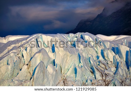 Matanuska glacier with dark clouds in the background. - stock photo
