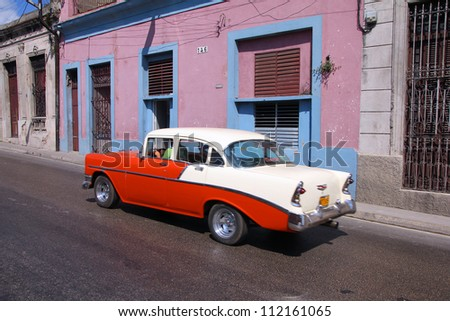 MATANZAS, CUBA - FEBRUARY 22: Man drives old American car on February 22, 2011 in Matanzas, Cuba. New change in law allows Cubans to trade cars. Cars in Cuba are very old because of the old law. - stock photo