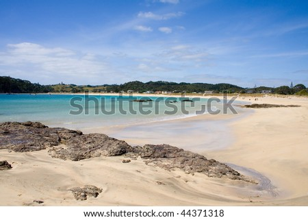 Matapouri Bay on a bright sunny day, a popular tourist destination in Northland, New Zealand - stock photo