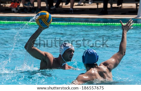 MATARO, SPAIN - APRIL 5: Players in action during the water polo Spanish League match between Mataro and Sant Andreu, final score 7-7, on April 5, 2014, in Mataro, Barcelona, Spain.