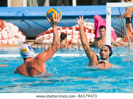 MATARO, SPAIN - OCTOBER 12: Unidentified water polo players in action during the Spanish League match between Mataro and CN Terrassa, final score 7-6, on October 12, 2011, in Mataro, Barcelona, Spain.