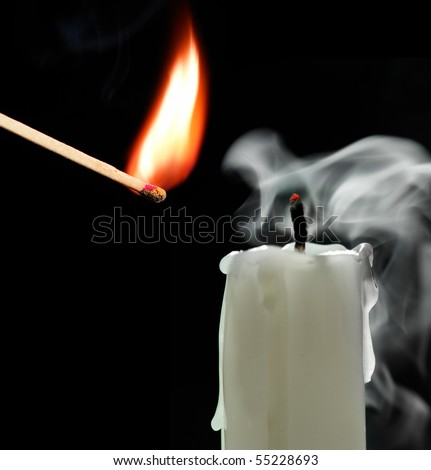 match and candle on a black background - stock photo