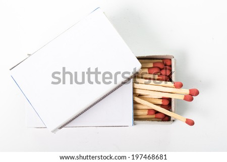 Match and matchbox isolated with white background - stock photo