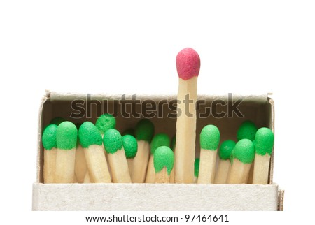 Match boxes and green matches (one match red). A white isolated background. - stock photo