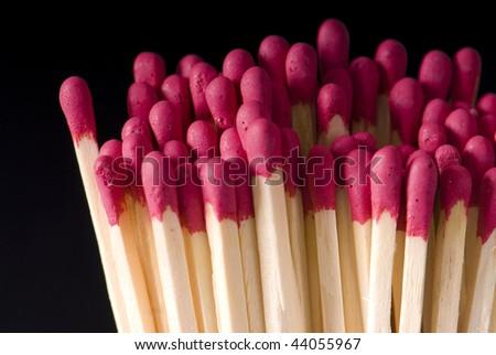 match on a black background - stock photo