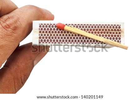 Match on matchbox with hand holding isolate - stock photo