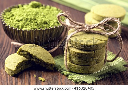 Matcha green tea cookies on a wooden table - stock photo