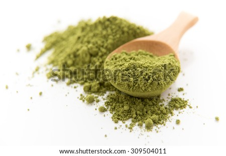 Matcha Green Tea in Bamboo Spoon on White Background - stock photo