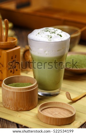 Matcha green tea latte in glass cup